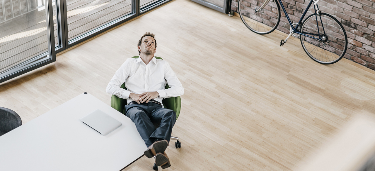 man thinking in his office