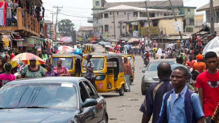 Ajegunle City, Lagos State Nigeria March 22, 2018: Busy Streets bustling with commercial activity; Shutterstock ID 1054621472; Departmental Cost Code : 162800; Project Code: GBLMKT; PO Number: GBLMKT; Other: