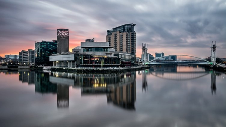 Long exposure at Salford Quays on a calm morning with beautiful sunrise and clear reflections.