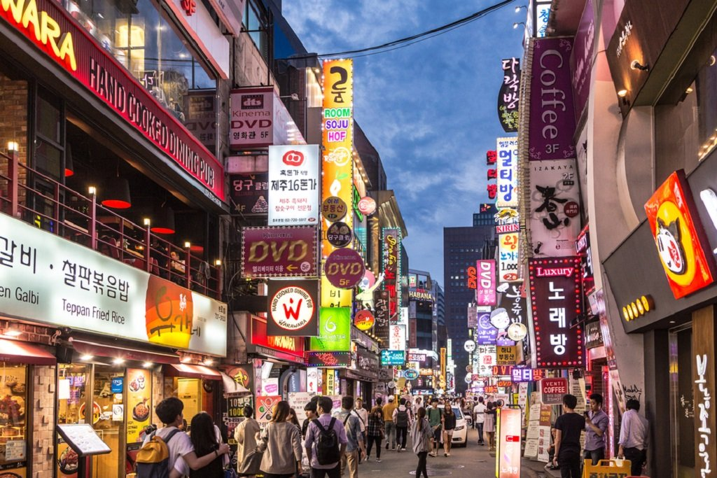 SEOUL, SOUTH KOREA - SEPTEMBER 12 2015: People wander in the walking street of the Myeong-dong shopping and entertainment district at night.; Shutterstock ID 332391542; Cost Center: JLL; Region: Global