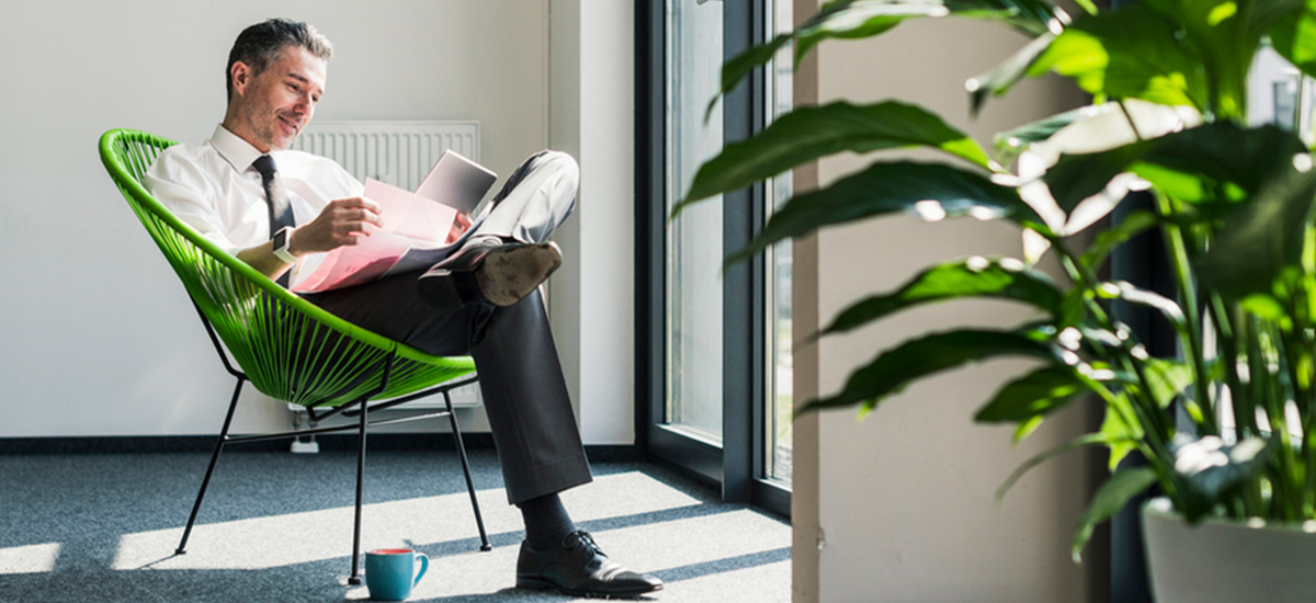 office worker sits in sustainable office